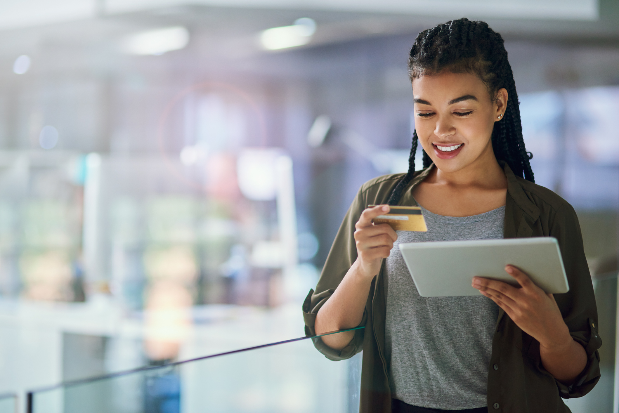 woman making a credit card purchase on a tablet